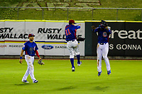 Tennessee Smokies outfielders Jacob Hannemann (7), Carlos Penalver (11) and Jeffrey Baez (33) celebrate a win during a Southern League game against the Biloxi Shuckers on May 25, 2017 at Smokies Stadium in Kodak, Tennessee.  Tennessee defeated Biloxi 10-4. (Mandy Krause/Krause Sports Photography)