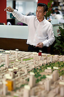 James Chew, deputy managing director of VinaProjects Co., talks about the economic future of Ho Chi Minh City over a model of the city...Kevin German / LUCEO