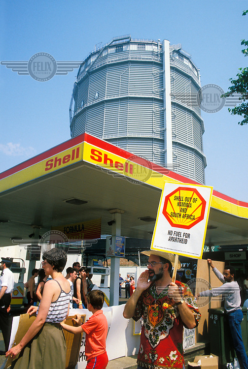 Anti apartheid demonstration at a petrol station in New York calling for Shell to disinvest from South Africa and Namibia.