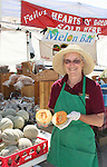 B. Ann Lattin shows off this years crop of hearts of gold melons at the 2008 Cantaloupe  Festival.  Photo by Tom Smedes.