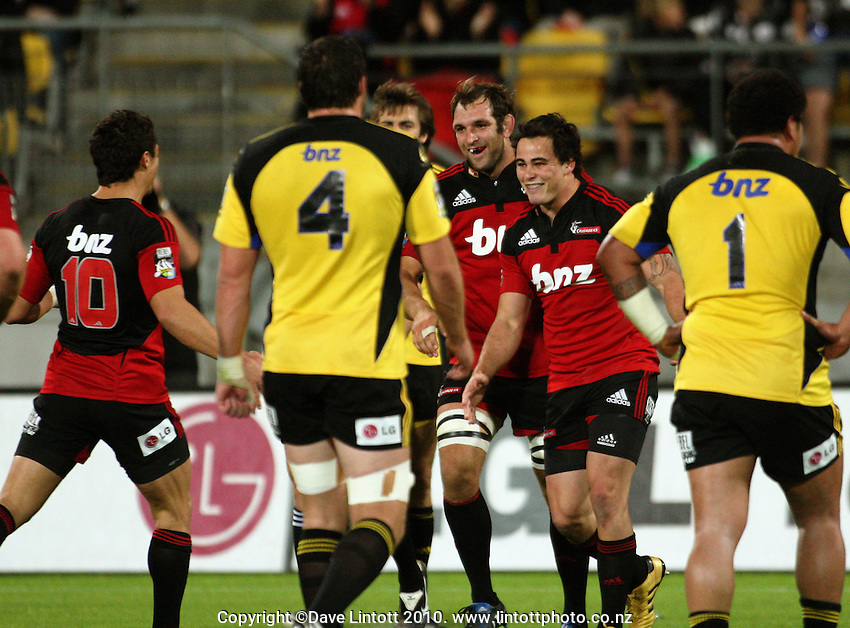Zac Guildford (second right) celebrates his try during the Super 14 rugby match between the Hurricanes and Crusaders at Westpac Stadium, Wellington, New Zealand on Friday, 2 April 2010. Photo: Dave Lintott / lintottphoto.co.nz