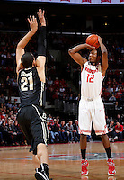 Ohio State Buckeyes forward Sam Thompson (12) shoots a three-point basket during the first half of the NCAA men's basketball game between the Ohio State Buckeyes and the Purdue Boilermakers at Value City Arena in Columbus, Ohio, on Saturday, Feb. 8, 2014. At the half, the Buckeyes led 29-22.  (Columbus Dispatch/Sam Greene)
