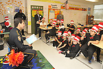 Harris County Sheriff Adrian Garcia reads to Cook ES students.