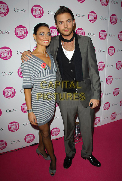 FLAVIA CACACE & MATT DI ANGELO.Arrivals - Cosmopolitan Fun Fearless Female Awards 2007 held at Cirque, Leicester Square, London, England, November 6th 2007..full length grey and silver striped dress suit black scarf.CAP/CAS.©Bob Cass/Capital Pictures.