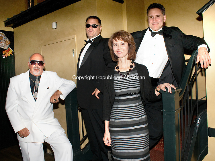 TORRINGTON- SEPTEMBER 24 2014 0092414DA01-  Janice Luise-Lutkus, center, of the Aspen Dream Productions Dinner Theater stands along side of, from left, Don Rondini, Frank Marcella and Anthony J. Urillo. The gentlemen act in Comedy Wedding &amp; Murder Mystery Dinner Theatre, of Mob&rsquo;s Murder Mystery. The entertainment company that writes and produces a variety of comedy and murder mystery shows is sure to bring a smile to your face. For more info on this production or other shows contact  www.aspendreamproductions.com<br /> Darlene Douty Republican American
