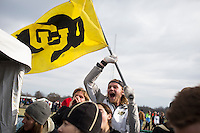 Reiny Barchet, a redshirt freshman member of the Colorado men's cross country team, waves a flag as he and others celebrate the team's title in Terre Haute, Ind. on Saturday, Nov. 22, 2014. (James Brosher, Special to the Denver Post)
