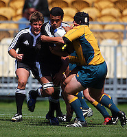 Josh Daley tries to contain Joseph Tupe during the International rugby match between New Zealand Secondary Schools and Suncorp Australia Secondary Schools at Yarrows Stadium, New Plymouth, New Zealand on Friday, 10 October 2008. Photo: Dave Lintott / lintottphoto.co.nz