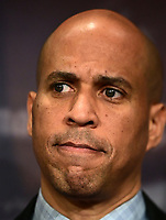 United States Senator Cory Booker (Democrat of New Jersey) listens to remarks at a press conference in the US Capitol in Washington, DC announcing a Democratic package of three bills to be introduced in the US Senate and US House to control prescription drug prices on Thursday, January 10, 2019.<br /> Credit: Ron Sachs / CNP /MediaPunch