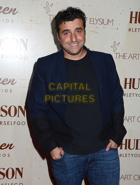 David Krumholtz<br /> Celebrity arrivals at The Art of Elysium's fifth annual GENISIS at Siren Studios Cube in Hollywood, CA, USA, 20th September 2013.<br /> half length hands in pockets navy black jacket blazer <br /> CAP/ADM/BT<br /> &copy;Birdie Thompson/AdMedia/Capital Pictures