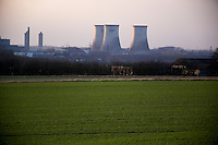 The Didcot Power Station is visible from the Wittenham Clumps in the Thames Valley as a storm approaches Didcot, Oxfordshire, England. The power plant used coal to generate electricity until March 2013. Now, part of the plant uses natural gas to generate power, and the cooling towers are planned to be demolished in 2014. The towers at the plant are some of the tallest structures in Britain.