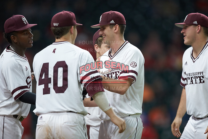 Mississippi State Bulldogs starting pitcher Ethan Small (44) is congratulated by his teammates as he walks off the field in the first inning of the game against the Mississippi State Bulldogs in game six of the 2018 Shriners Hospitals for Children College Classic at Minute Maid Park on March 3, 2018 in Houston, Texas. The Bulldogs defeated the Cougars 3-2 in 12 innings. (Brian Westerholt/Four Seam Images)