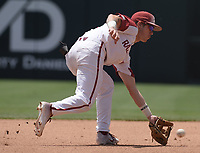 NWA Democrat-Gazette/ANDY SHUPE<br /> Arkansas shortstop Casey Martin fields a ground ball against Ole Miss Saturday, June 8, 2019, during the fourth inning in the NCAA Super Regional game at Baum-Walker Stadium in Fayetteville. Visit nwadg.com/photos to see more photographs from the game.