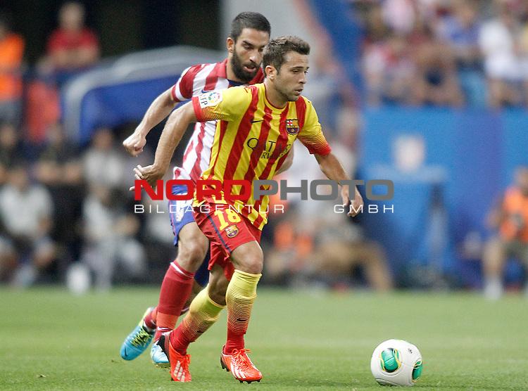 Atletico de Madrid's Arda Turan (l) and FC Barcelona's Jordi Alba during Supercup of Spain 1st match.August 21,2013. Foto © nph / Acero)
