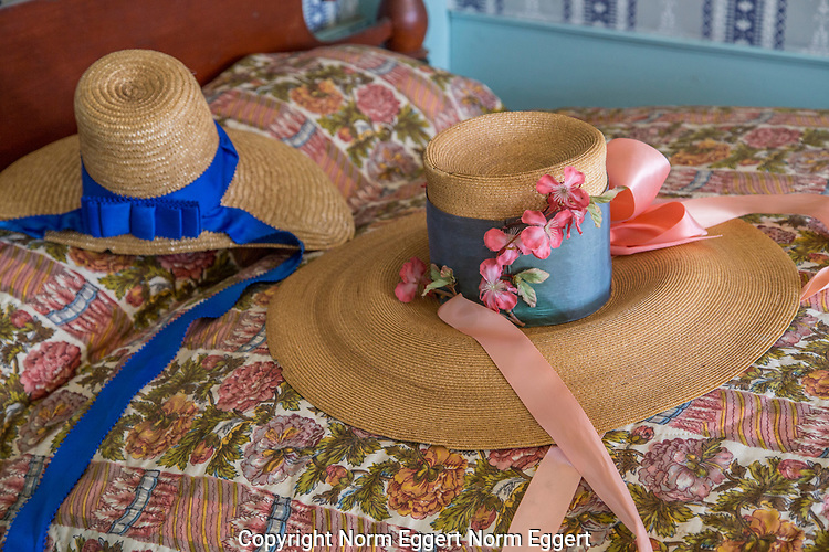 Hats on a bed in the Freeman Farm at OSV