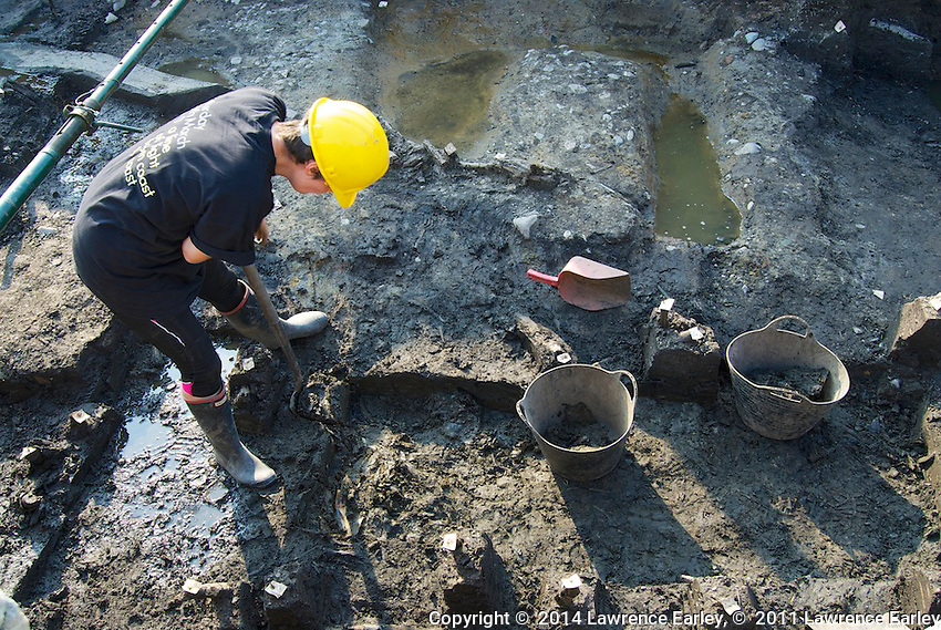 Day 6 - At Vindolanda Fort excavations; volunteer digs chunks of soil to find pieces of Roman correspondence.