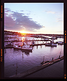USA, Washington State, Seattle, a view of fishing boats and the sun setting from the Freemont Bridge
