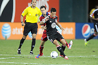 D.C. United midfielder Marcelo Saragosa (11) shields the ball from Chicago Fire Marco Pappa (16) D.C. United defeated The Chicago Fire 4-2 at RFK Stadium, Wednesday August 22, 2012.