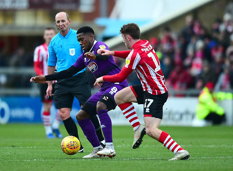Grimsby Town's Mitch Rose shields the ball from  Lincoln City's Shay McCartan<br /> <br /> Photographer Andrew Vaughan/CameraSport<br /> <br /> The EFL Sky Bet League Two - Lincoln City v Grimsby Town - Saturday 19 January 2019 - Sincil Bank - Lincoln<br /> <br /> World Copyright &copy; 2019 CameraSport. All rights reserved. 43 Linden Ave. Countesthorpe. Leicester. England. LE8 5PG - Tel: +44 (0) 116 277 4147 - admin@camerasport.com - www.camerasport.com