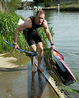 26 MAY 2013 - BRIGG, GBR - A competitor lifts his kayak from the water at the end of his  kayak leg of the 2013 Brigg Bomber Quadrathlon, a World Quadrathlon Federation World Cup round and the British Championships, held in Brigg in Lincolnshire, Great Britain (PHOTO (C) 2013 NIGEL FARROW)