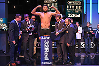 Joe Joyce on the scales during a Weigh In at the BT Studios, Queen Elizabeth Olympic Park on 12th July 2019