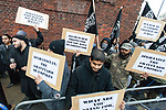 © Joel Goodman - 07973 332324 - all rights reserved . 11/11/2010 . London , UK . Siddhartha Dhar (bottom centre) . Muslims Against Crusades hold a demonstration and burn a poppy on the anniversary of Armistice Day , at Kensington Gore , opposed by a demonstration of nationalist groups including the English Defence League ( EDL ) . Photo credit : Joel Goodman