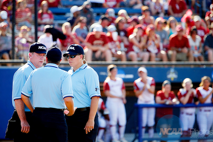 08 JUNE 2016:  The umpires have a discussion during the Division I Women's Softball Championship is held at ASA Hall of Fame Stadium in Oklahoma City, OK.  Shane Bevel/NCAA Photos