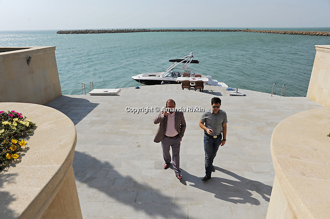 (L-r) Ibrahim Ibrahimov, an Azerbaijani oligarch and billionaire, is seen with his assistant and protege, Shahin Talibov, Vice-President of Avesta Concern, at the edge of the Caspian Sea outside one of several of his homes in the Garadagh region just southwest of Baku, Azerbaijan on July 18, 2012.  Ibrahimov is the developer behind the Khazar Islands artificial islands project; in his private life, he enjoys building a home for his family, moving in, and then quickly tires of the property before building a new home on an adjacent lot on his seaside lands.