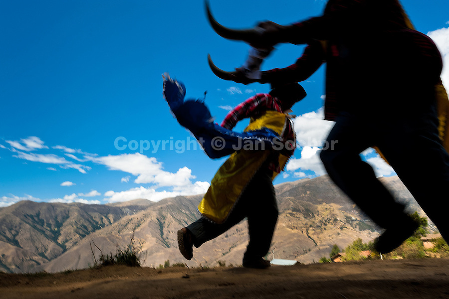 Peruvian peasants perform a fake bullfight during the Yawar Fiesta, a ritual fight between the condor and the bull, held in the mountains of Apurímac, Cotabambas, Peru, 30 July 2012. The Yawar Fiesta (Feast of Blood), an indigenous tradition which dates back to the time of the conquest, consists basically of an extraordinary bullfight in which three protagonists take part - a wild condor, a wild bull and brave young men of the neighboring communities. The captured condor, a sacred bird venerated by the Indians, is tied in the back of the bull which is carefully selected for its strength and pugnacity. A condor symbolizes the native inhabitants of the Andes, while a bull symbolically represents the Spanish invaders. Young boys, chasing the fighting animals, wish to show their courage in front of the community. However, the Indians usually do not allow the animals to fight for a long time because death or harm of the condor is interpreted as a sign of misfortune to the community.