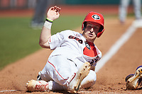 Mason Meadows (30) of the Georgia Bulldogs slides across home plate during the game against the LSU Tigers at Foley Field on March 23, 2019 in Athens, Georgia. The Bulldogs defeated the Tigers 2-0. (Brian Westerholt/Four Seam Images)
