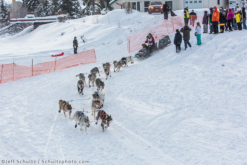 Yvonne Dabakk of Oslo, Norway drops down onto the Chena River with her team shortly after the start of the 2015 Iditarod sled dog race. in Fairbanks. Photo by Todd Paris/IditarodPhotos.com 2015