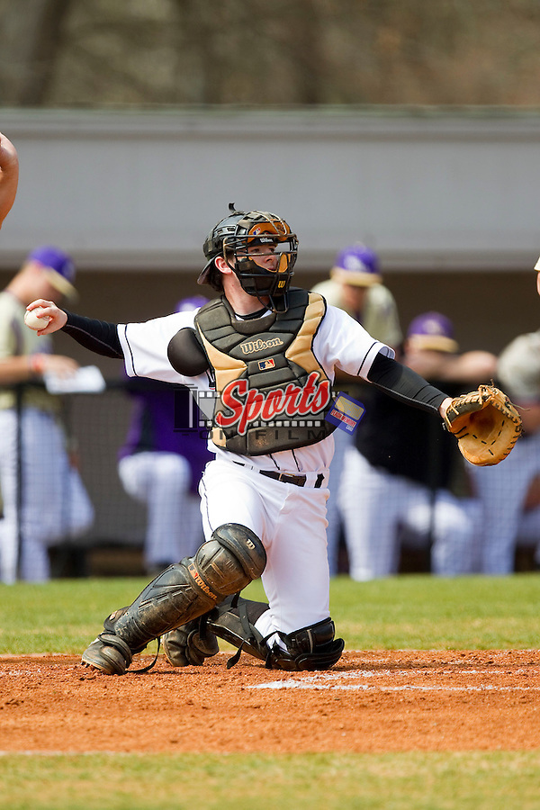 Davidson Wildcats catcher Chris Dyer (19) throws the ball back to his pitcher during the game against the Western Carolina Catamounts at Wilson Field on March 10, 2013 in Davidson, North Carolina.  The Catamounts defeated the Wildcats 5-2.  (Brian Westerholt/Sports On Film)