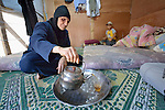Ayush Nadir pours tea in a tent in a settlement of Syrian refugees in Minyara, a village in the Akkar district of northern Lebanon. Lebanon hosts some 1.5 million refugees from Syria, yet allows no large camps to be established. So refugees have moved into poor neighborhoods or established small informal settlements in border areas. International Orthodox Christian Charities, a member of the ACT Alliance, provides support for families in this settlement.