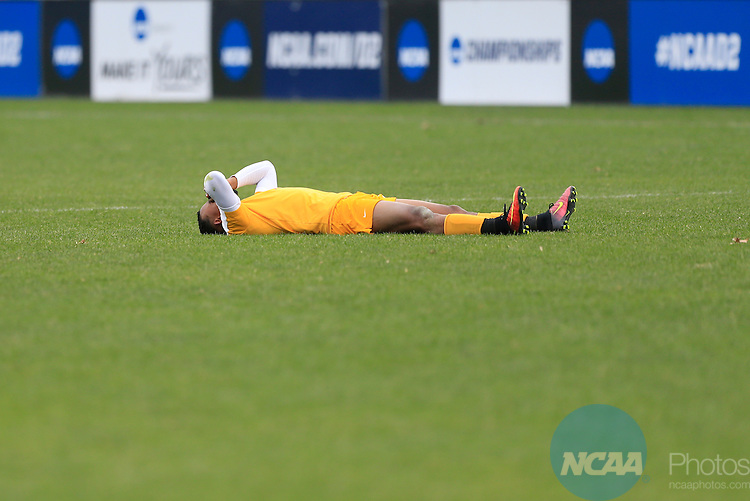 KANSAS CITY, MO - DECEMBER 03:  Bruno Oliviera (3) of the University of Charleston reacts as Wingate University celebrates their victory during the Division II Men's Soccer Championship held at Children's Mercy Victory Field at Swope Soccer Village on December 03, 2016 in Kansas City, Missouri. Wingate beat Charleston 2-0 to win the National Championship. (Photo by Jack Dempsey/NCAA Photos via Getty Images)