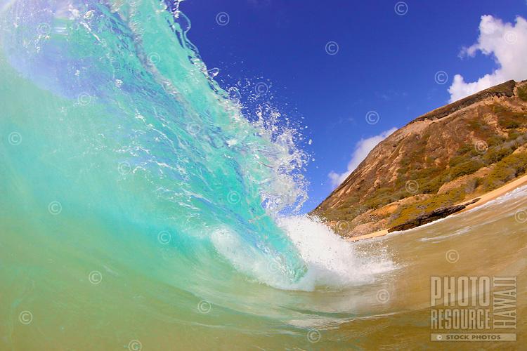 A wave barrels at Gas Chambers on Oahu's Sandy Beach.