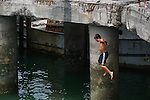 CHILD JUMPS IN WATER OFF PIER (7)