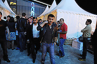 Emin Agalarov, the son-in-law of Azerbaijan's President Ilham Aliyev and the nation's top male pop star, exits the backstage area to perform on the Caspian seaside Bulvar at the Eurovsion Song Contest Fan Club concert on April 29, 2012.  Agalarov is married to Leyla Aliyeva, the eldest daughter of Azerbaijani President Ilham Aliyev who holds many hats in her own right, among them head of the Heydar Aliyev Foundation in Russia, editor of Baku Magazine, artist, and poet and Agalarov's father, Aras Agalarov, is a Russian billionaire oligarch of Azerbaijani origin in the retail and real estate development sectors, being the first to bring foreign luxury fashion brands to Russia after the collapse of communism and opening several gaudy malls and arenas in Moscow and elsewhere in Russia.