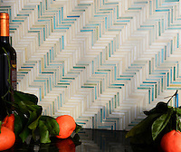 Houndstooth, a handmade mosaic backsplash shown in Aquamarine and Quartz jewel glass, is part of the Houndstooth Collection by Sara Baldwin for New Ravenna.<br />