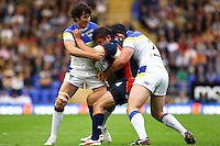 PICTURE BY ALEX WHITEHEAD/SWPIX.COM - Rugby League - Super League Play-Off - Warrington Wolves vs St Helens - The Halliwell Jones Stadium, Warrington, England - 15/09/12 - St Helens' Jon Wilkin is tackled by Warrington's Stefan Ratchford and Chris Hill.