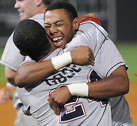 Sept. 18, 2009: Anthony Gose, left, and Jeremy Hamilton of the Lakewood BlueClaws hug after winning Game 4 of the South Atlantic League Championship Series against the Greenville Drive 5-1 at Fluor Field at the West End in Greenville, S.C. Lakewood won the series 3 games to 1. Photo by: Tom Priddy/MiLB.com