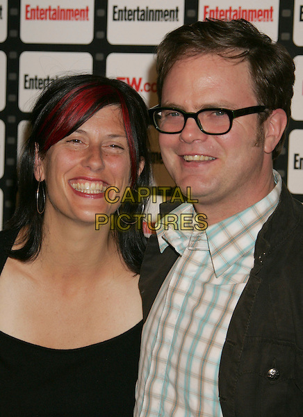 HOLLY REINHORN & RAINN WILSON.Entertainment Weekly Magazine Celebrates The 2006 Photo Issue Party held at Quixote Studios, Hollywood, California , USA, 04 October 2006..portrait headshot glasses.Ref: ADM/RE.www.capitalpictures.com.sales@capitalpictures.com.©Russ Elliot/AdMedia/Capital Pictures.