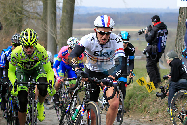 Riders including British National Champion Ian Stannard (Sky Procycling) struggle up the 23%  Koppenberg climb during the 2013 Tour of Flanders, Belgium, Sunday 31st  March 2013 (Photo by Eoin Clarke 2013)
