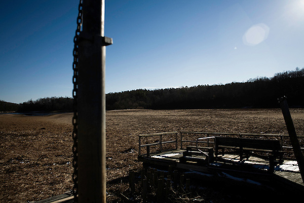 """January 21, 2008. Bahama, NC.. Photos of Lake Michie, the main reservoir for the city of Durham, NC. .The drought crisis in the Durham area has reached the """"critical"""" level, with an estimated 119 days of easily accessible drinking water remaining.. A boat dock sits in the dry river bed, now covered in grass."""