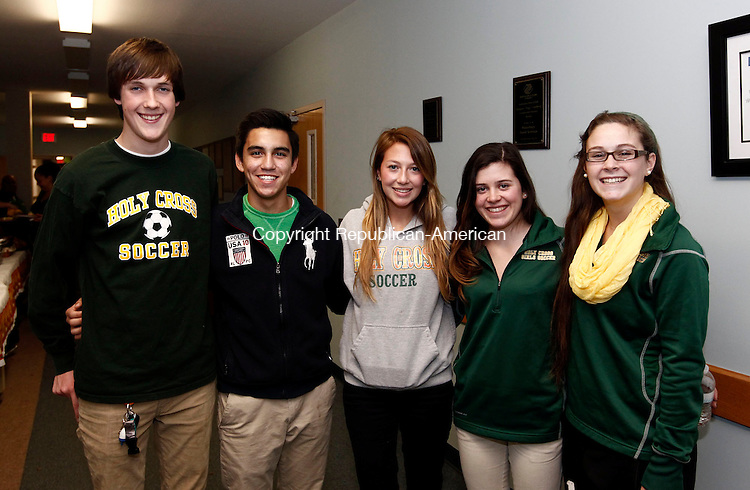 Waterbury, CT- 26 November 2013-112613CM10-  SOCIAL MOMENTS: Left to right: (Volunteers from the Holy Cross soccer teams) Patrick Budris, 16, Philip Mongelluzzo, 16, Livia Donofrio, 16, Caitlin Villano, 16 and Elizabeth Czapor, 17 during the annual Waterbury Youth Services Family Thanksgiving Dinner at their building in Waterbury Tuesday afternoon.   Christopher Massa Republican-America