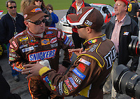 Feb 11, 2007; Daytona, FL, USA; Nascar Nextel Cup driver Ricky Rudd (88) talks with teammate David Gilliland (38) after Gilliland qualified on the pole for the Daytona 500 at Daytona International Speedway. Mandatory Credit: Mark J. Rebilas