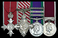 BNPS.co.uk (01202 558833)<br /> Pic: DNW/BNPS<br /> <br /> The medal group awarded to Major Alan Wiles. <br /> <br /> The incredible tale of Argentina's little known first invasion of the Falklands islands revealed as Royal Marine heroes medals are sold.<br /> <br /> The medal group of a Royal Marine who was taken hostage by Argentinian terrorists when they tried to claim the Falklands 16 years before the war are being sold.<br /> <br /> Major Alan Wiles was serving as a PT instructor for the Dad's Army-like Falkland Islands Defence Force when a hijacked Argentine airliner landed on the racecourse at Stanley. <br /> <br /> Thinking the Douglas DC-4 plane was in distress the British army officer, who was trout fishing at the time, rushed to the scene only to be met by 18 armed hijackers.<br /> <br /> The El Condor group, that had forced the pilot at gunpoint to divert 400 miles to the Falklands, raised the Argentine flag and demanded Britain recognised the islands as their country's.<br /> <br /> They surrendered less than 24 hours later.<br /> <br /> Now Maj Wiles medals are coming up for auction in London.