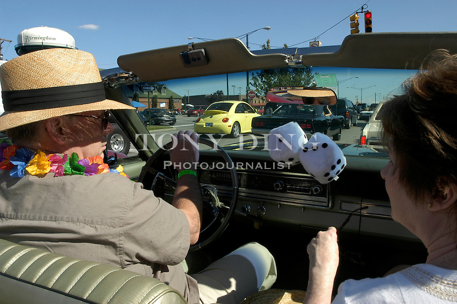Ben and Carol Wold cruise down Woodward Ave. in Birmingham, Mich. in their 1966 Ford Fairlane 500 convertible for the 10th Anniversary Woodward Dream Cruise on Saturday, August 21, 2004. The couple of 38 years dated in the car. (Photo by TONY DING).