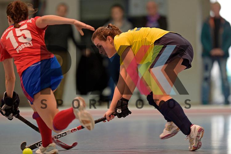 GER - Mannheim, Germany, January 17: During the Oberliga-Damen indoor hockey match between Feudenheimer HC (red) and  TSV Ludwigsburg (yellow) on January 17, 2016 at Irma-Roechling-Halle in Mannheim, Germany. Final score 8-2 (HT 3-1).  Madeleine Adamidis  #30 of TSV Ludwigsburg<br /> <br /> Foto &copy; PIX-Sportfotos *** Foto ist honorarpflichtig! *** Auf Anfrage in hoeherer Qualitaet/Aufloesung. Belegexemplar erbeten. Veroeffentlichung ausschliesslich fuer journalistisch-publizistische Zwecke. For editorial use only.