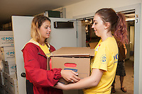 Ashley Sabia,'20, and Micayla Yorski,'20, move boxes of magazines to a storage area at the Redwood Library in Newport as they take part in Salve's Exploration Day of Service