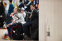 New England Revolution head coach Jay Heaps watches from the end of the bench. The New York Red Bulls defeated the New England Revolution 4-1 during a Major League Soccer (MLS) match at Red Bull Arena in Harrison, NJ, on March 20, 2013.