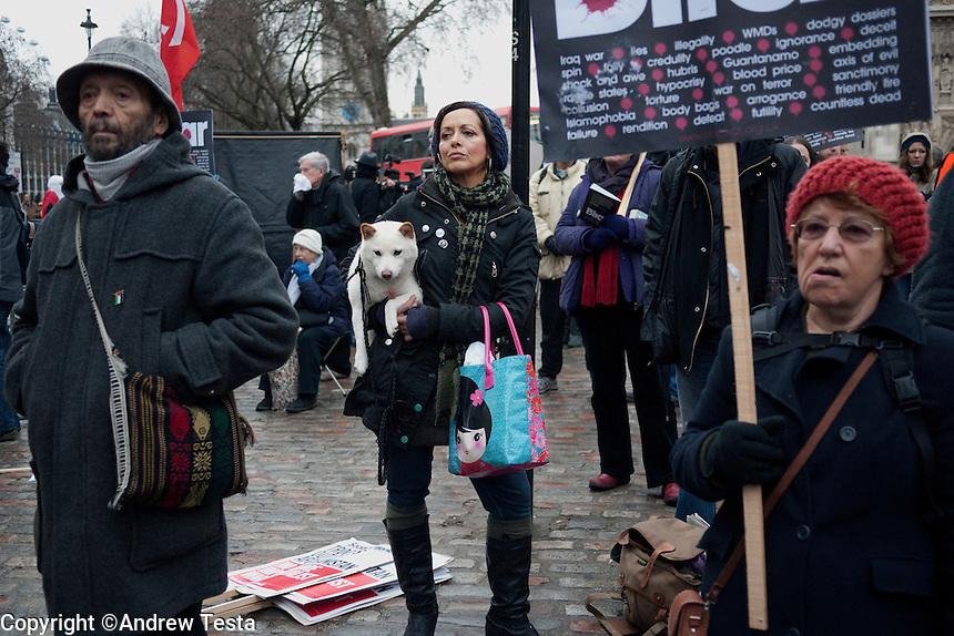 UK. London. 29th January 2010.Demonstrators against Tony Blair listen to speeches outside the Chilcot Inquiry where he was due to give evidence on the Iraq war..©Andrew Testa for the New York Times